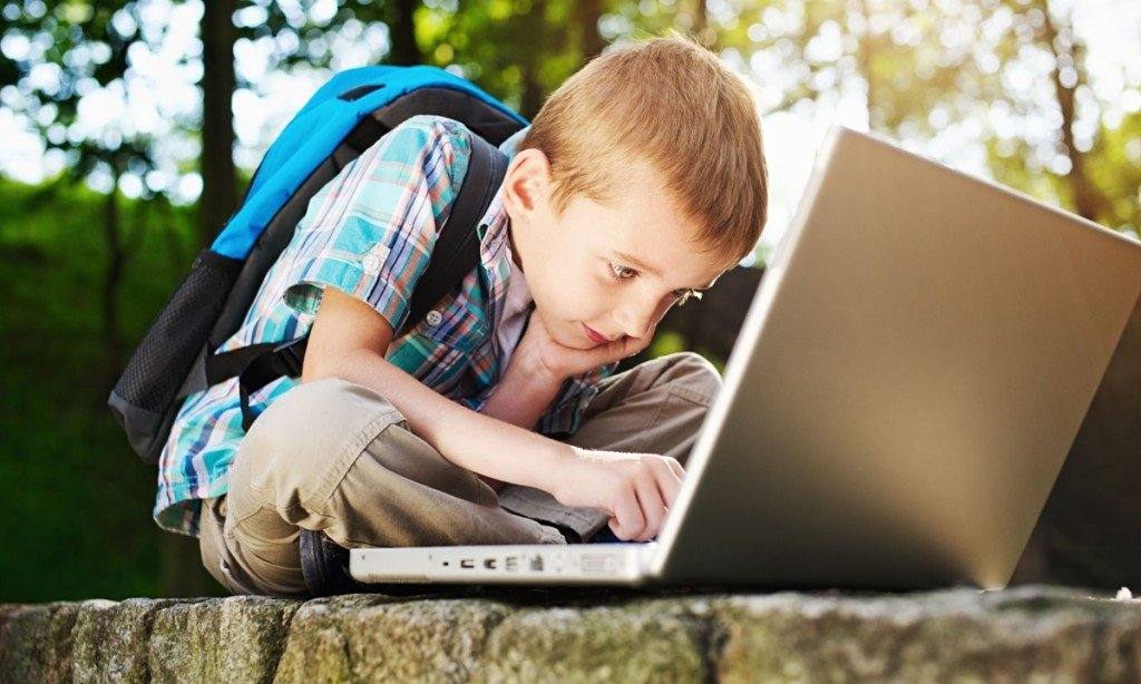 Optimized-Boy-focused-on-notebook-014